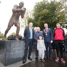 Lord Mayor Brian Kingston unveils the statue with artist Mark Richards, former British bantamweight champion Davy Larmour and young boxers Jordan Hamilton and Zak Larmour