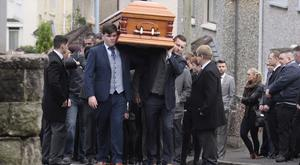 Karl Lamont (right) carries the coffin of his father Mark at his funeral in Coleraine