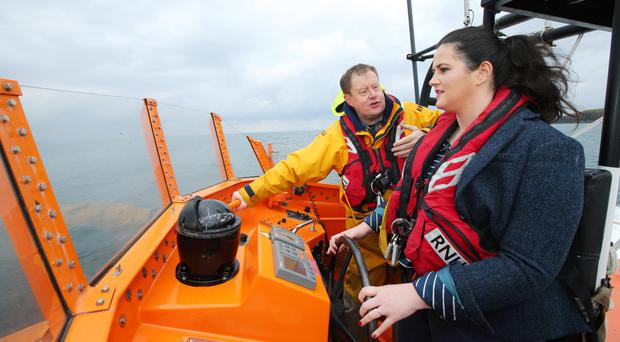 Justice Minister Claire Sugden with Coxswain Mark Mitchell on board the RNLI Lifeboat