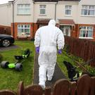 Forensic officers and canine units at the scene of a suspected ammunition and explosives find in the Foxes Glen area