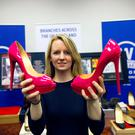 Belfast Telegraph journalist Sophie Inge with some of the luxury items due to go under the hammer at Wilsons Auctions, all Government Seized Assets