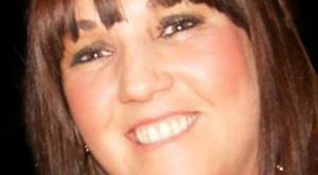 A man wanted by the PSNI in connection with the murder of a west Belfast mother-of-three is fighting for his life after taking an overdose in an Irish prison