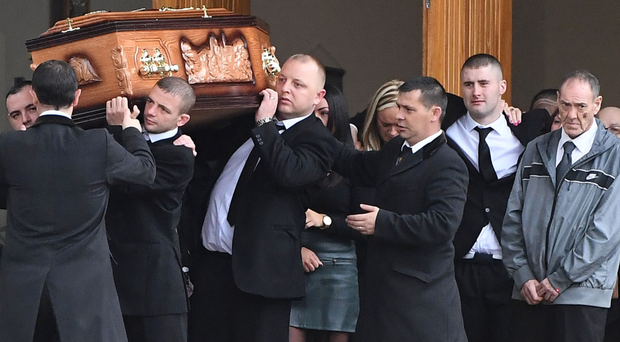 Family and friends attending the funeral of murdered man Joe Reilly in Poleglass, west Belfast