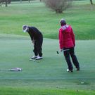 Golfers putting on the third hole at Balmoral Golf Club in south Belfast