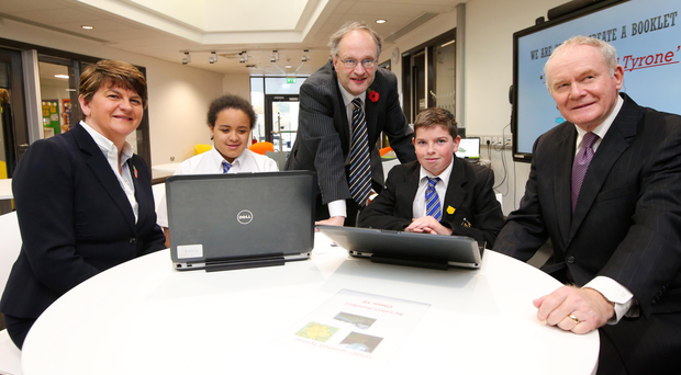 First Minister Arlene Foster, deputy First Minister Martin McGuinness (right) and Education Minister Peter Weir with pupils Chantelle Salaja and Calvin Hamilton at the opening of the Arvalee School and Resource Centre in Omagh yesterday