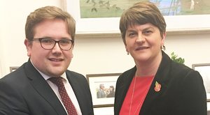 DUP leader Arlene Foster welcomes former UUP councillor Aaron Callan