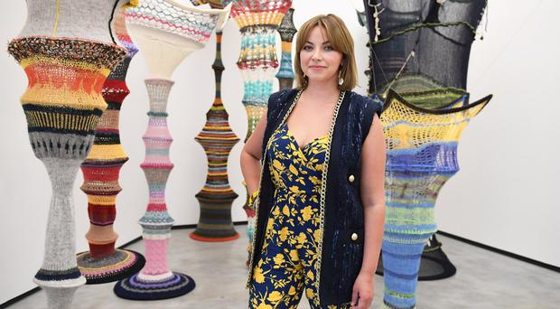 Singer Charlotte Church admiring artwork at the MAC, Belfast