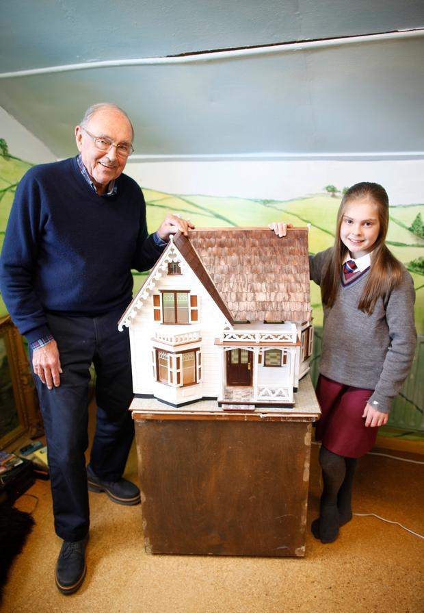 Libby Nesbitt (10) with her grandfather Terry Monro (78) who built the amazing doll's house