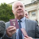 Raymond McCord with his newly issued Irish passport alongside his British passport