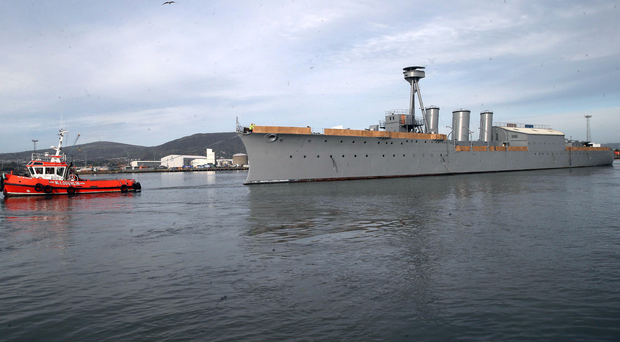 HMS Caroline moves from Alexandra Dock to Harland and Wolff's heavy industries Belfast Dock for repair