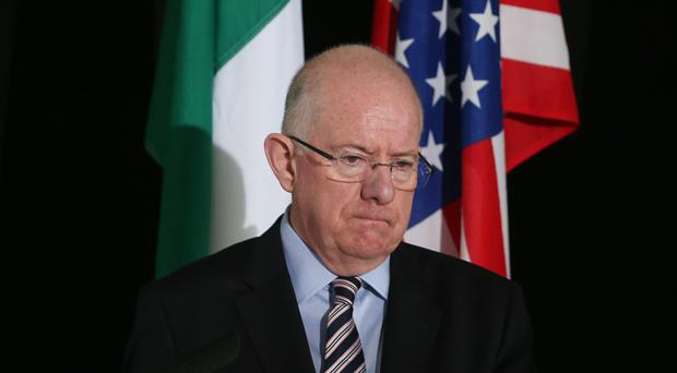 Charlie Flanagan expressed his concerns during a press conference with US secretary of state John Kerry