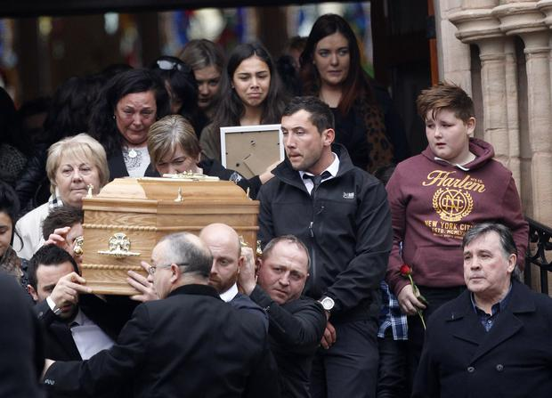 Friends and family walk behind the coffin of Amy Reid in Cookstown after Requiem Mass at Holy Trinity Church