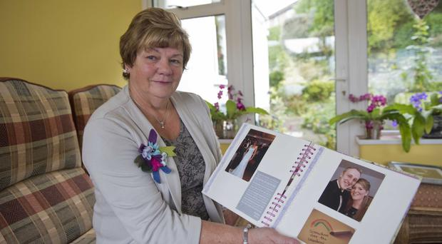 Eva Reilly with her late daughter Lynette's wedding album