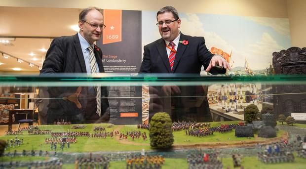 Education Minister Peter Weir in the Museum of Orange Heritage in Belfast with curator Dr Jonathan Mattison