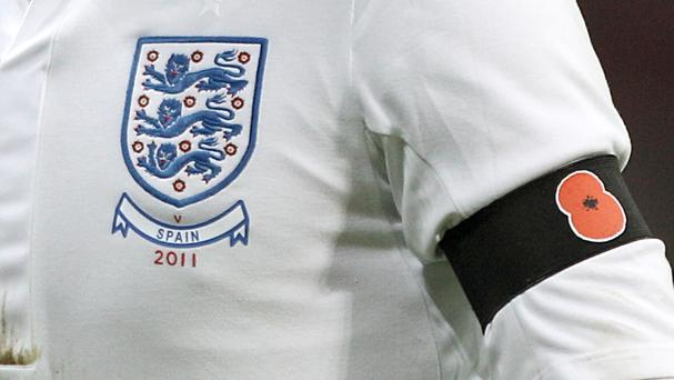 England players wore a black armband with a poppy symbol on for a friendly against Spain in 2011
