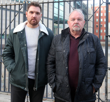Ian Hamilton's brother Ross and father Charles outside court yesterday