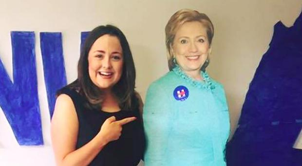 Cliona McCarney with life-size cutout of Hillary Clinton