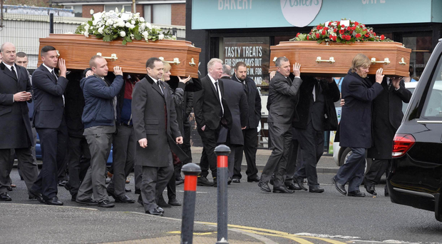 Mourners carry the coffins of Gavin and Mark Scott, who died suddenly in Newtownabbey last Friday