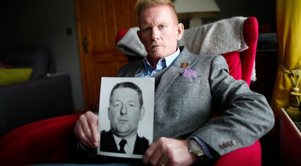Enduring anguish : Stephen Gault holds a picture of his father Samuel, who was killed in the Enniskillen bomb