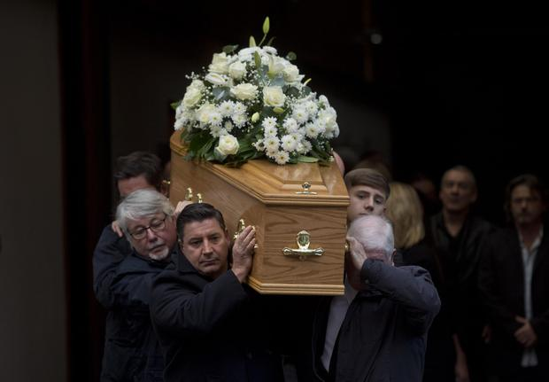 The coffin of musician Bap Kennedy, brother of singer-songwriter Brian Kenned is carried from the funeral home in Belfast city centre