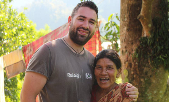 Kieran with one of the villagers