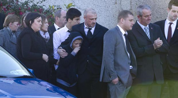 Tanya Nesbitt's partner Paul and son Cody at her funeral in Elim Pentecostal Church, Markethill