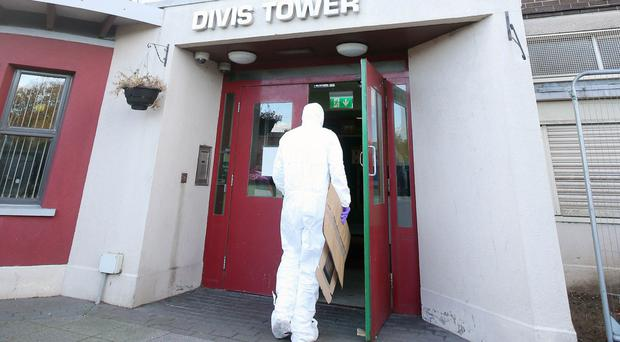 A PSNI forensics officer enters Divis Tower yesterday