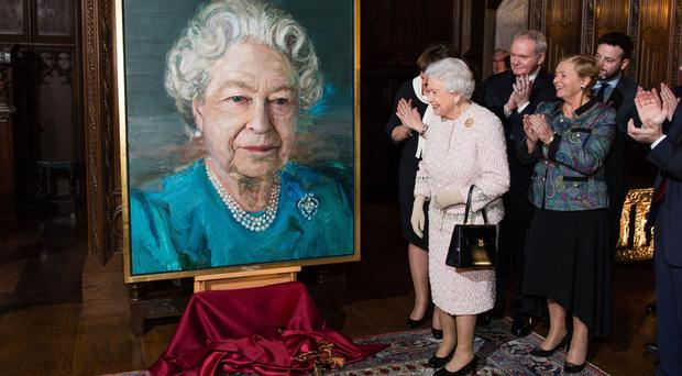 The Queen unveiled a portrait of herself by artist Colin Davidson.
