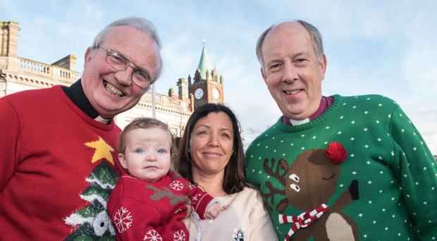Bishop Donal McKeown and Bishop Ken Good with Louise James and baby Rioghnach-Ann at the launch of the world record attempt