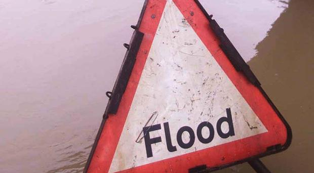 Three teenagers were caught when flood waters trapped their car on the Livery Road in Stranocum, Co Antrim