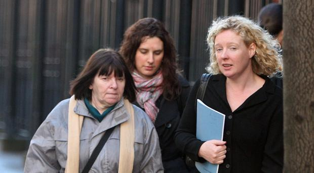 Barrister Karen Quinlivan, right, with Pearse Jordan's mother Teresa, leaving the hearing in Belfast