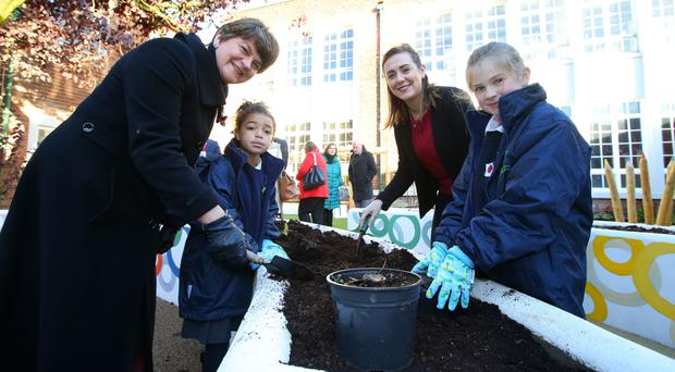 First Minister Arlene Foster and Junior Minister Megan Fearon with pupils Jayla Houston and Maleah Taft