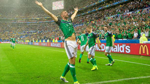 Northern Ireland's Gareth McAuley celebrates scoring at Euro 2016