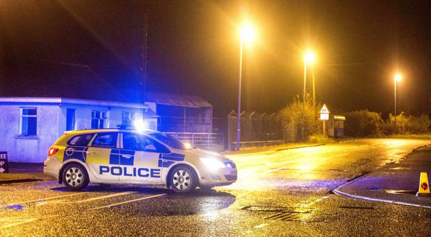 Police at the scene of Sunday evening's shooting at Bann Road, Ballymoney