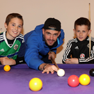 Kyle Lafferty playing pool with fans at Daisy Lodge