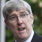 Amalgamation approved by ex-minister John O'Dowd
