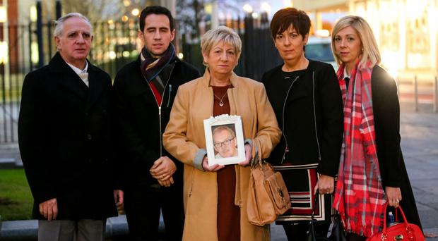Bernadette Hannaway and other family members with a photo of her late husband, Alfie