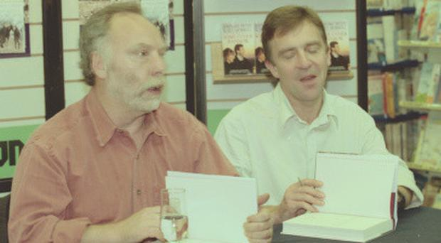 Brian Keenan and John McCarthy signing books in 1999
