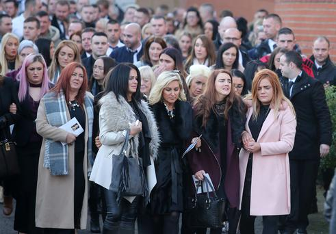 Family and friends at the funeral of Kevin Kearney at the Holy Family Church in north Belfast