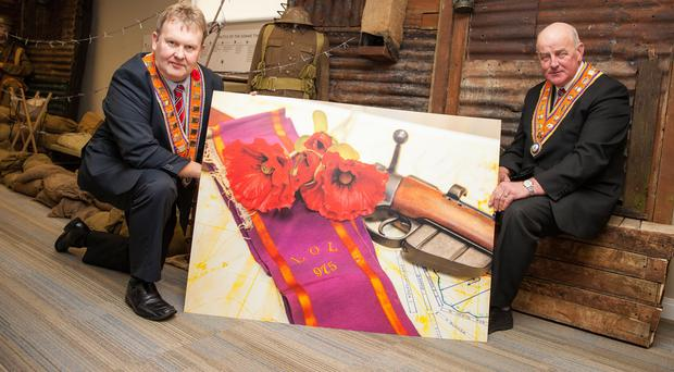 Grand Master of the Grand Orange Lodge of Ireland Edward Stevenson (right) and Deputy Grand Master Harold Henning with one of the exhibits