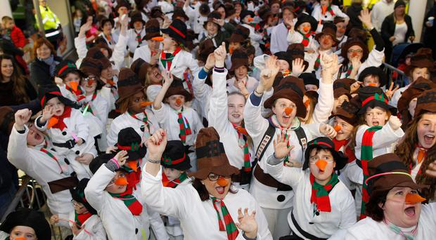 Hundreds of snowmen come together for the world record attempt at the Buttercrane Shopping Centre in Newry yesterday