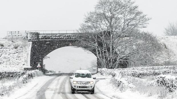 A car on the road between Ingleton and Hawes in the Yorkshire Dales National Park after winter weather brought snow to high ground across the north of England.