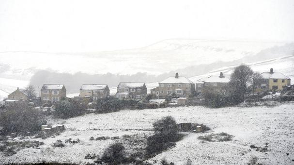 Covered houses in Buxton after winter weather brought snow to high ground across the Peak District.