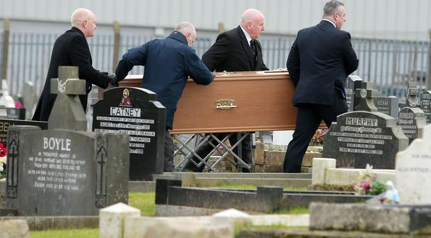 The body of Daniel Rooney who was shot dead by the Army in 1972 is exhumed from his grave at the family's plot in Milltown Cemetery