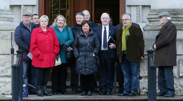 Relatives of those killed by the Glenanne gang in the 1970s at the High Court in Belfast yesterday