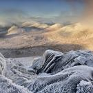 Sunrise from the summit of Slieve Bearnagh in the Mourne Mountains evokes the wintry settings of CS Lewis's Narnia, the land he based on the Co Down mountain range