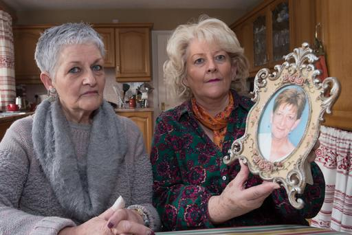 Mary Higgins (left) and Kathleen Hart with a picture of their late sister Patricia Brolly