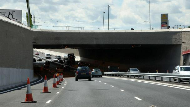 The interchange would allow non-stop traffic flow between the Westlink (pictured), M2 and M3 with a new bridge and underpasses