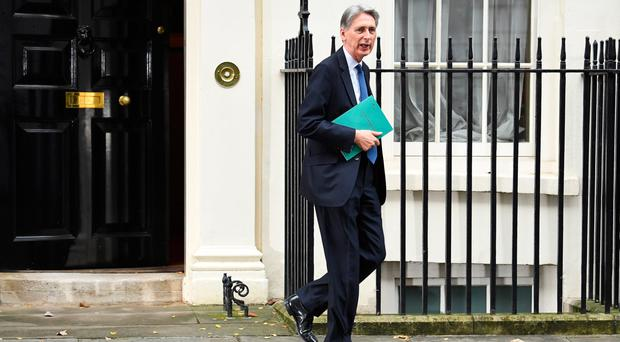 Chancellor Philip Hammond leaves 11 Downing Street yesterday for the House of Commons to deliver his Autumn Statement