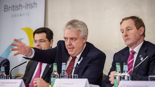 James Brokenshire, Carwyn Jones and Enda Kenny during a press conference at the British Irish Council summit at the Vale Resort near Cardiff